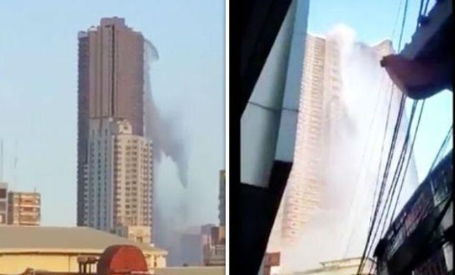 Бассейн выливается с крыши небоскреба: случайное видео прохожих