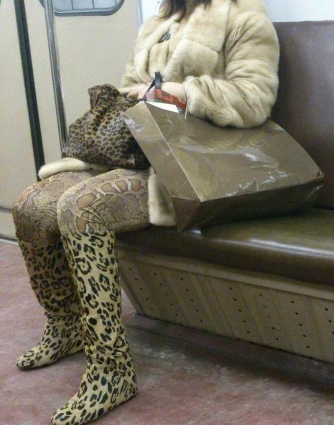 леопард съедает питона