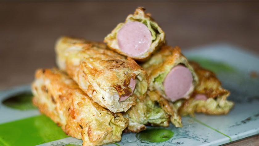 Сосиски в капустных листьях: интересная закуска на скорую руку
