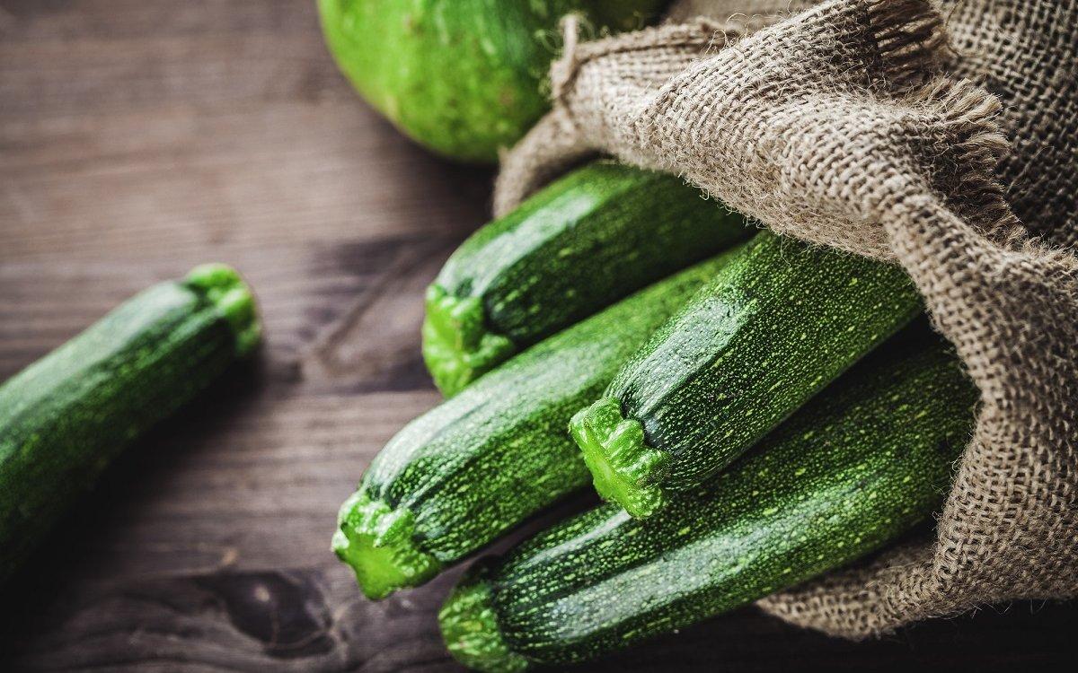 : fresh zucchini in a jute sack