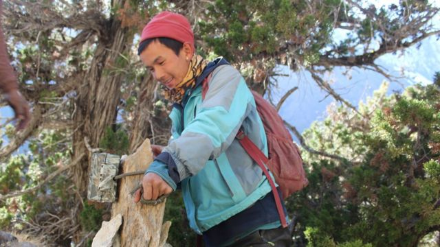 Tshewang Gurung setting up a camera-trap on a mountain in Upper Dolpo region of Western Nepal