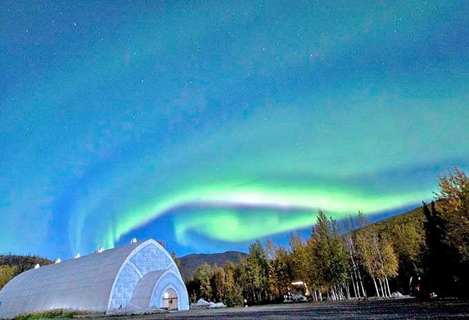 Aurora over ice museum at Chena Hot Springs Resort Alaska USA by Travis Knauss