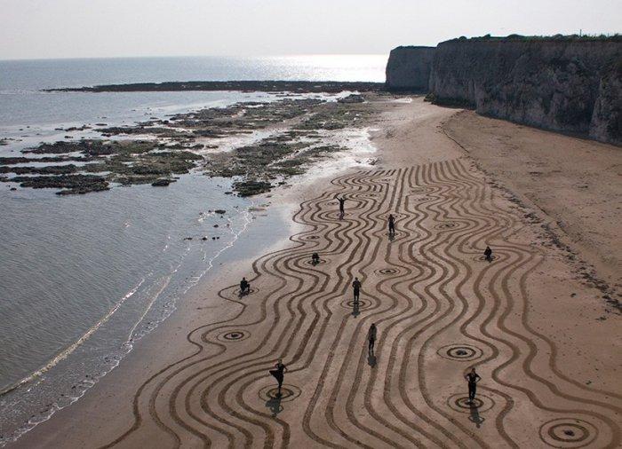 Рисунки на песке Сэма Дугадо