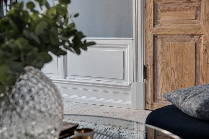 Дровяная печь, винтажный стол и овечка: необычный интерьер в Швеции (44 кв. м)