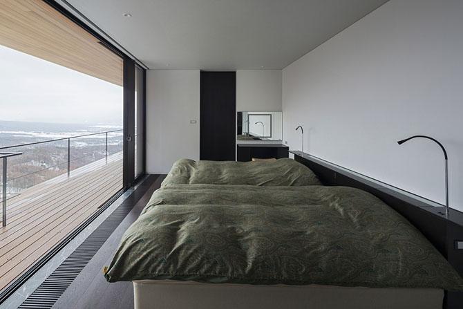 Дизайнерский дом на живописном склоне Фото