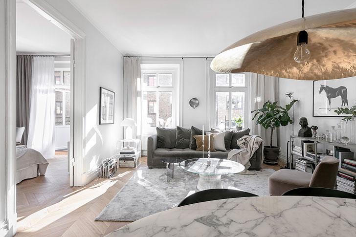 Белая квартира с изящным декором (67 кв. м)