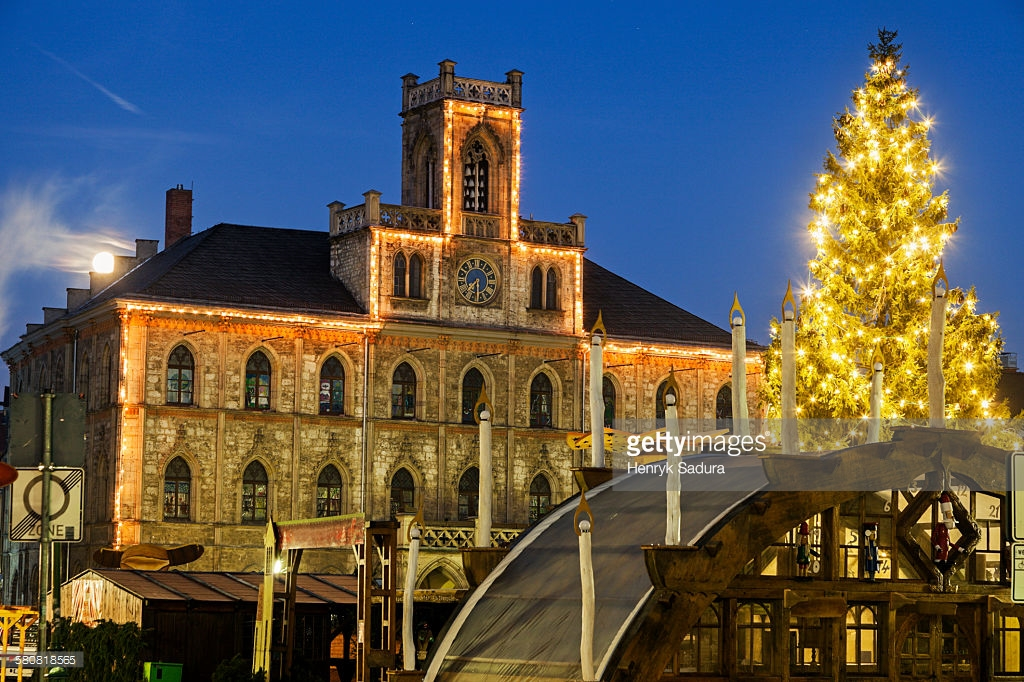 Germany, Thuringia, Weimar, Illuminated Christmas tree and town hall : Stock Photo