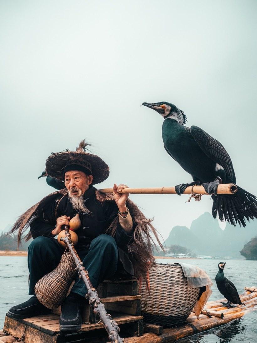 Фотограф сделал потрясающую серию снимков о традиционной китайской рыбалке
