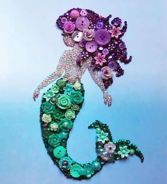 How gorgeous is this mermaid!!?? It would be a stunning unique gift for someone special or yourself! The background is a blue ombré effect and the mermaid herself is made from Buttons, resin flowers, pearls and diamantes in purple and teal - all individually hand placed. She is just #artsandcraftsgifts, #outdoordiygifts