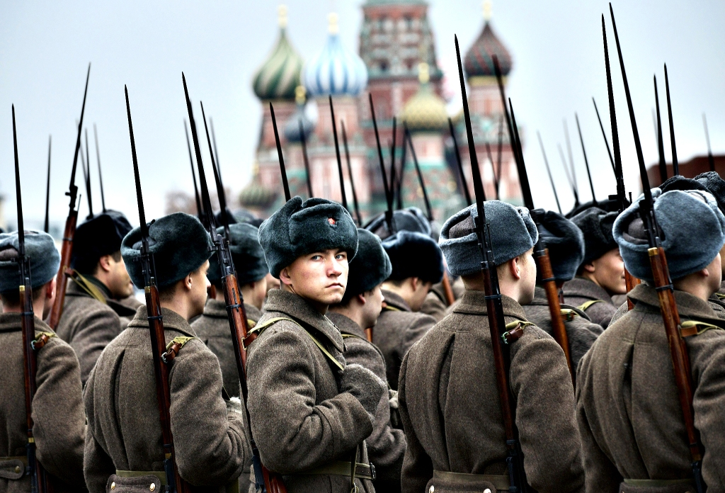 Russian soldiers dressed in Red Army World War II uniforms prepare to parade in Red Square in front of a backdrop of St. Basil Cathedral in Moscow, Russia, Thursday, Nov. 7, 2013. Thousands of Russian soldiers and military cadets marched across Red Square to mark the 72nd anniversary of a historic World War II parade. The show honored the participants of the Nov. 7, 1941 parade who headed directly to the front lines to defend Moscow from the Nazi forces. The parade Thursday involved about 6,000 people, many of them dressed in World War II-era uniforms. (AP Photo/Alexander Zemlianichenko)