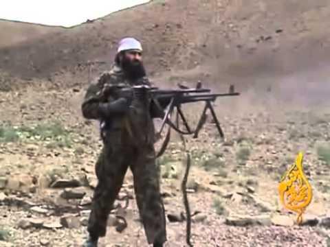С двумя пулеметами.Кричит Аллах Акбар.